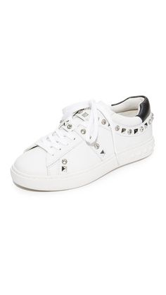 ¡Consigue este tipo de zapatillas bajas de ASH ahora! Haz clic para ver los detalles. Envíos gratis a toda España. Ash Play Studded Sneakers: Pyramid studs and glittering crystals add bold, edgy stile to these bright leather Ash sneakers. Contrast heel cap at the padded collar. Lace-up closure. Embossed platform. Rubber sole. Leather: Calfskin. Imported, China. This item cannot be gift-boxed. (zapatillas bajas, baja, bamba, bamba básica, bambas, low, low-tops, corte bajo, sneakers, tenis ...