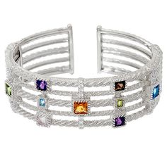 Geo gems. This captivating sterling silver cuff from Judith Ripka is an artful arrangement of colorful gemstones--including citrine, peridot, Swiss topaz, amethyst, rose quartz, and smoky quartz. QVC.com