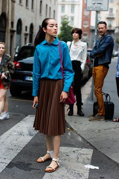 sun fei fei in a button up + pleated skirt & flats #modelstreetstyle