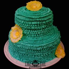 A small wedding cake or even baby shower cake. This was for the middle of a rainy winter so I wanted to make sunshine in cake form. It was such a bright and happy cake! All buttercream cake with gumpaste fantasy flowers. Lake Union Cafe & Custom Bakery