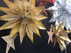 Paper stars,  spray painted with gold - silver - copper