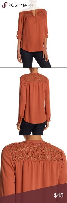 "Daniel Rainn Crochet Yoke Blouse Terracotta colored Blouse by Daniel Rainn  A crochet yoke frames the narrowly split neck of a woven top that's outfitted with convertible sleeves for styling versatility. - Split neck - Long sleeves - Button cuffs - Roll-up sleeve tabs - Approx. 27"" length Self: 100% polyester Contrast: 100% cotton Daniel Rainn Tops Blouses"