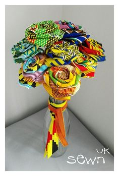 Fabric Roses, Flowers that last! - African Kente Designs with Bendy Stems. Perfect as Gifts, Table Centrepieces or simply for the home African Party Theme, African Wedding Theme, Traditional Wedding Decor, African Traditional Wedding, Decoration Evenementielle, African Accessories, African Home Decor, African Flowers, Fabric Roses