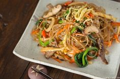 Flavorful and exquisite Japchae is made of sweet potato noodles, julienne vegetables, and sliced beef tossed in a Korean soy sauce mix.