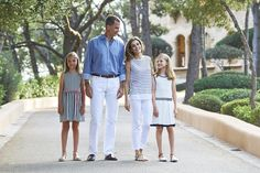 King Felipe VI and Queen Letizia posed for casual family photographs with their two young daughters, Crown Princess Leonor, 10, and Princess Sofia, 9, at Marivent Palace
