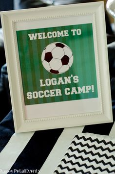 """I always liked framing signs for a party. I think this would be a cute idea to use. The party would be themed """"Aidan's Soccer Camp"""" Oh you should also frame his invite to put on the gift table. You can get a white frame for cheap on our Marshall's Friday Runs. LOL"""