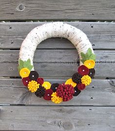 How to Make a Yarn Fall Wreath (Video) . Watch how to create a yarn wreath complete with fall decorations and embellishments for your fall home.