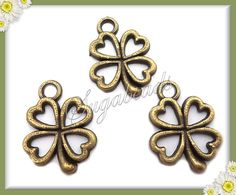 10 Antiqued Brass Metal Lucky Four Leaf Clover Charms by sugabeads, $2.25