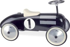 Vilac Black Ride On Classic Car is a stylish, vintage inspired toy and piece of decor for your little one\'s room. #nursery #kidsroom #vilac #vilactoys #oliverthomas #kidstoys #toys #rideoncar #vintage #vintagetoys