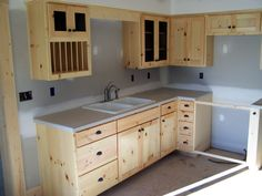 Kitchen || Raw wood cabinets + Concrete counters