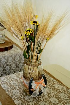 Big mason jar decorated with burlap, lace, orange gingham, a horse shoe, small sunflowers and wheat sat on top of hand made burlap and lace table runners Wheat Decorations, Horseshoe Decorations, Mason Jar Centerpieces, Mason Jars, Small Sunflower, Wedding Stuff, Wedding Ideas, Lace Table Runners, Burlap Lace