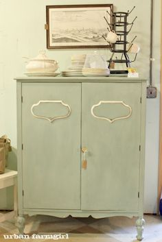 Add silver metal cabinet embelish and some paint to an old cabinet- or to downstairs dresser to label what crafts are inside