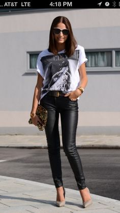 Black leather skinnies, nude pumps, graphic tee, sunglasses, leopard clutch, black belt, gold bracelet / watch