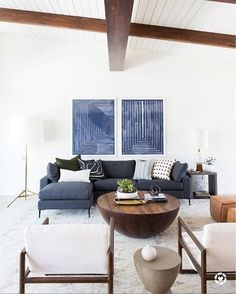Mid-century great room with modern sectional, round coffee table, and modern artwork. Living Pequeños, Blue Couch Living Room, Blue Living Room Decor, Living Room Sectional, Living Room Colors, New Living Room, Living Room Designs, Modern Sectional, Small Sectional