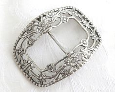 Antique solid silver large belt buckle with floral open work pattern, made in…