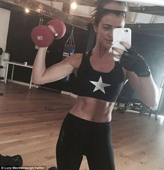 Ab goals: Newly-single Lucy unveiled her toned tummy in a new gym selfie, posted on her Tw...