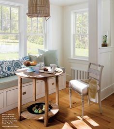 Sunny Breakfast Nook by Lisa K. Lisa turned a mariner-style basket upside down as a pendant lamp over antique Spanish warming table. Swedish dining chair, custom window seat and pillows keep things cozy. Photo by Eric Roth. Dining Room Bench, Kitchen Benches, Cozy Kitchen, Dining Nook, Dining Room Design, Dining Table, Kitchen Design, Nook Table, Kitchen Banquette
