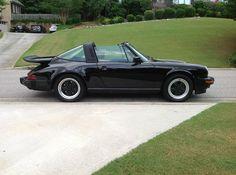 1986 PORSCHE 911 CARRERA 930 TARGA 3.2-liter - Black. The rear spoiler is an option.