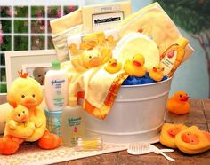 """Baby Wash Tub     Tearless Baby Shampoo by Johnson & Johnson 7 oz     Musical Mommy & Me Duckling that plays, """"Old McDonald Had A Farm"""" by Russ     Berrie     2 Tee Shirts 100% Cotton     Hooded Baby Bath Towel of various designs     2 Baby Hats     4 Wash Cloths Terry Cloth     5×7 Picture Frame     3 Rubber Duckies     Baby Booties     Baby Brush & Comb Set     Ultra Soft Baby Duckling Blanket, satin edged, embroidered with """"Duckling     Under the Covers""""     Baby Duck Finger Puppet…"""