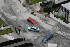 liquefaction, christchurch nz, 22 feb 2011. At the time I wondered why people drove into the holes that opened up in the roads, but then I realised that the holes opened up under the cars as they were driving.