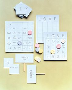 "These game pieces are easy to make.Love Bingo How-To1. Print grids of 16 squares onto card stock. Number squares randomly, 1 to 16.2. For paddles, glue a craft stick between two card-stock rectangles; write bride's name on one side, groom's on the other.3. Number 16 cards 1 through 16; on the back of each, write something about the bride or groom (""hates bugs"" or ""Madonna fan""). Each player gets a bingo board, paddle, and candy ""chips."" The leader reads ..."