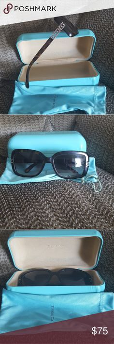 Tiffany Sunglasses Gorgeous Tiffany sunglasses! This is a great starter pair! Good used condition though they could benefit  from a professional cleaning. Comes with original case and dustbag! Case is a little dinged up from being in my purse but still in great condition! Tiffany & Co. Accessories Sunglasses