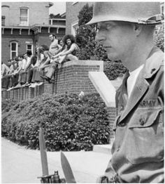 National Guardsman in front of Baker Center (Old), students looking on, May 1970 :: Ohio University Archives