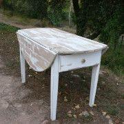 Mesa con alas abatibles decapada en blanco