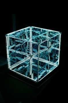 N-Light Objects by Numen: Geometric primitives paneled with one-way mirrors allow you to see into an infinite geometric space.