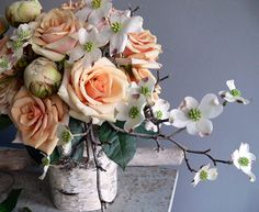 Roses, dogwood, & peonies - love the color & the birch bark (it's just wrapped around a tin can)!