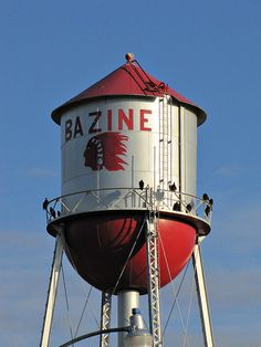 The water tower in Bazine, Kansas is painted with local school colors  and boasts the school mascot