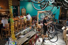 With urban cycling on the rise, bike-repair shops are adding unusual perks to stay competitive, from bars with craft beer to mini-cafes with coffee, fresh-pressed vegetable juices and smoothies and baked goods. Bicycle Cafe, Bicycle Store, Urban Cycling, Vintage Cycles, Camping World, Store Displays, Cool Bikes, Store Design, Craft Beer
