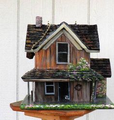 Brown Farm House Bird House, Hand Painted, Handmade with American Flag, Flowers and Miniatures. $169.00, via Etsy.