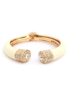 Cast in elegant ivory, it features a double dose of crystals and gold
