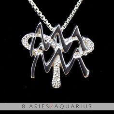 11 Aries and Aquarius Silver Unity Pendant. $99.99, via Etsy.