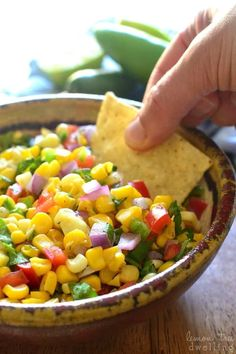 Fresh Corn Salsa - made with just 7 simple ingredients and perfect for dipping, topping, or eating by the spoonful! Can we talk for a minute about girls and