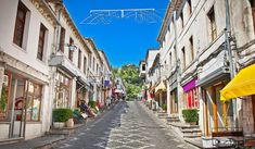 """The museum city of Gjirokastra was built on the eastern side of """"Mali i Gjerë"""". Since it has been in UNESCO World Heritage site. The origin of the city starts with the castle of Gjirokastra, built in IV century … Albania Travel, Visit Albania, Stone Town, Travel Vlog, Luxury Travel, View Photos, Beautiful Places, Places To Visit, Adventure"""