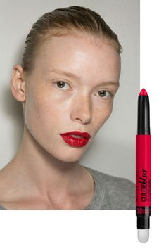 """Makeup artist Yadim topped two shades of liquid lipstick with loose pigment to lend the classic crimson mouth a modern """"velvet"""" finish. For a similar look, try dusting a cherry-colored blush over Maybelline New York Lip Studio Color Blur Matte Pencil in Partner in Crimson ($9)."""