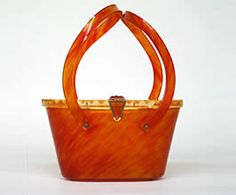 Purse made of Lucite, designed by Maxim, 1950s. (Peggy Cone Collection, 2001.104.71)