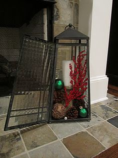 lantern filled with pine cones, Christmas balls, candle & berries