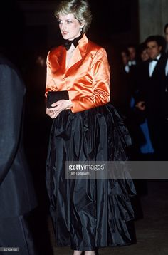 Princess Diana Wearing A Black Evening Skirt With Bustle, Orange Jacket And Bow Tie During Her Official Visit To Lisbon, Portugal.