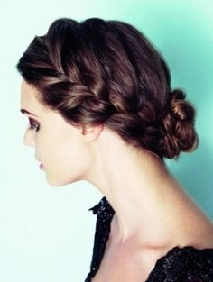 Loose braid into a bun at the nape of the neck.