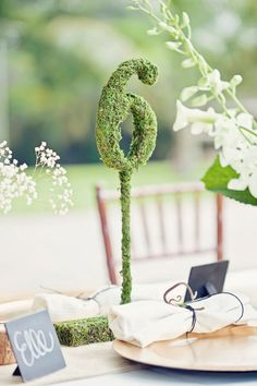 Moss covered table numbers for garden partys and outdoor weddings!  www.spottedleopard.etsy.com