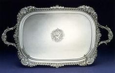 Emes &  Barnard - A George III silver Tray, London 1819  Emes & Barnard  Apprenticed to Charles Wright in 1781 and turned over to Thomas Chawner in 1784, Edward Barnard I became Chawner's foreman in 1786. He became free of the Goldsmiths' Company in 1789 and in 1808 entered his mark in partnership with Rebeccah Emes. Becoming one of the most successful establishments in London,