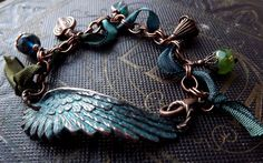 Angel wing bracelet with teal blue patina, copper charms and gypsy ribbon