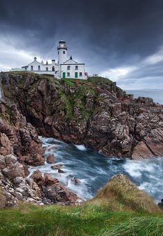 Fanad Lighthouse captured on a cold and windy October morning. Just below the Lighthouse to the left is a large cave that bellows with the sound of the Atlantic waves that surges in and out. This impressive lighthouse sits on the end of the Fanad peninsula on the western shore of Donegal. Because of its location it can safeguard ships in the North Atlantic and the entrance to Swilly Lough.