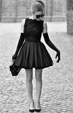 Short, black, lacy dress with puffy skirt