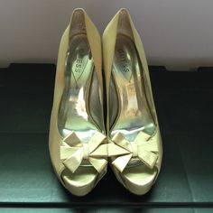 Gold Guess heels with bow I bought these shoes for my grandparents 50th wedding anniversary and only wore them a handful of times. The heel height is about 4½ inches. Guess Shoes Heels
