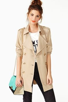 """Chic khaki trench coat featuring double-breasted button closures and ruched sleeves. Flap detailing at bust and pleated back. Detachable belt, partially lined. Looks perfect tossed over a tank and high-waist skinnies!  *30.5"""" length  *25"""" bust   *Model is wearing size small  *Measurements taken from size small  *Dry clean only  *Imported"""