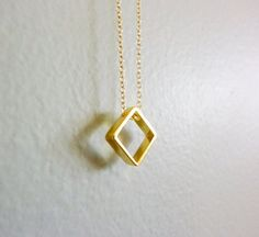 gold square charm necklace-gold square necklace-simple gold necklace-geometric necklace-diamond shape charm necklace. $39.00, via Etsy.